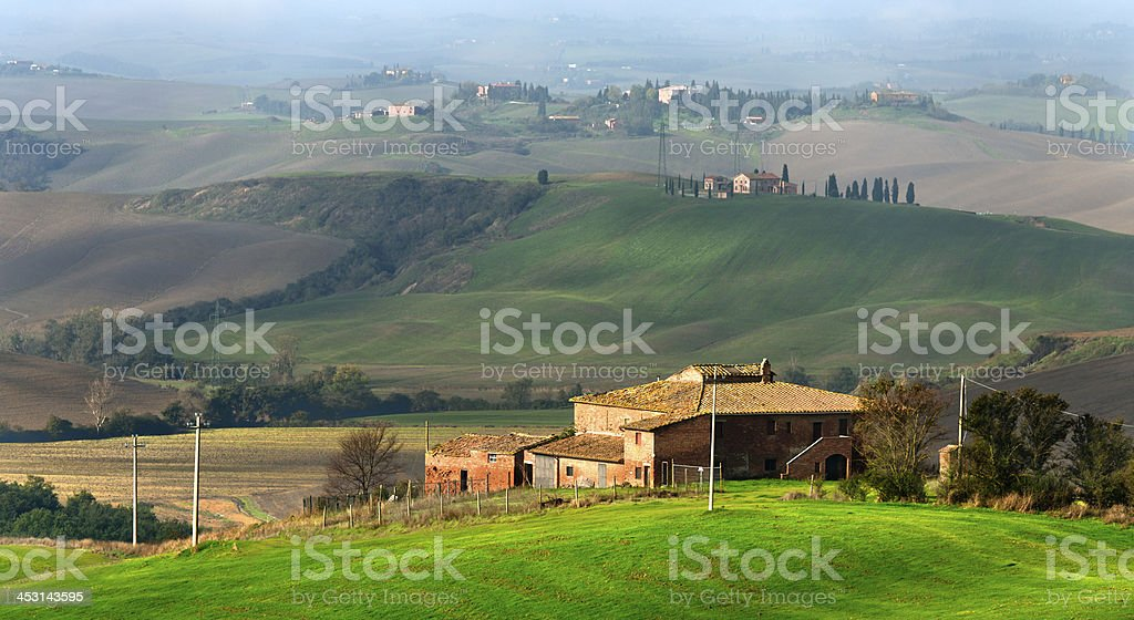 Farmhouse on hill in landscape of Crete Senesi, Tuscany, Italy royalty-free stock photo