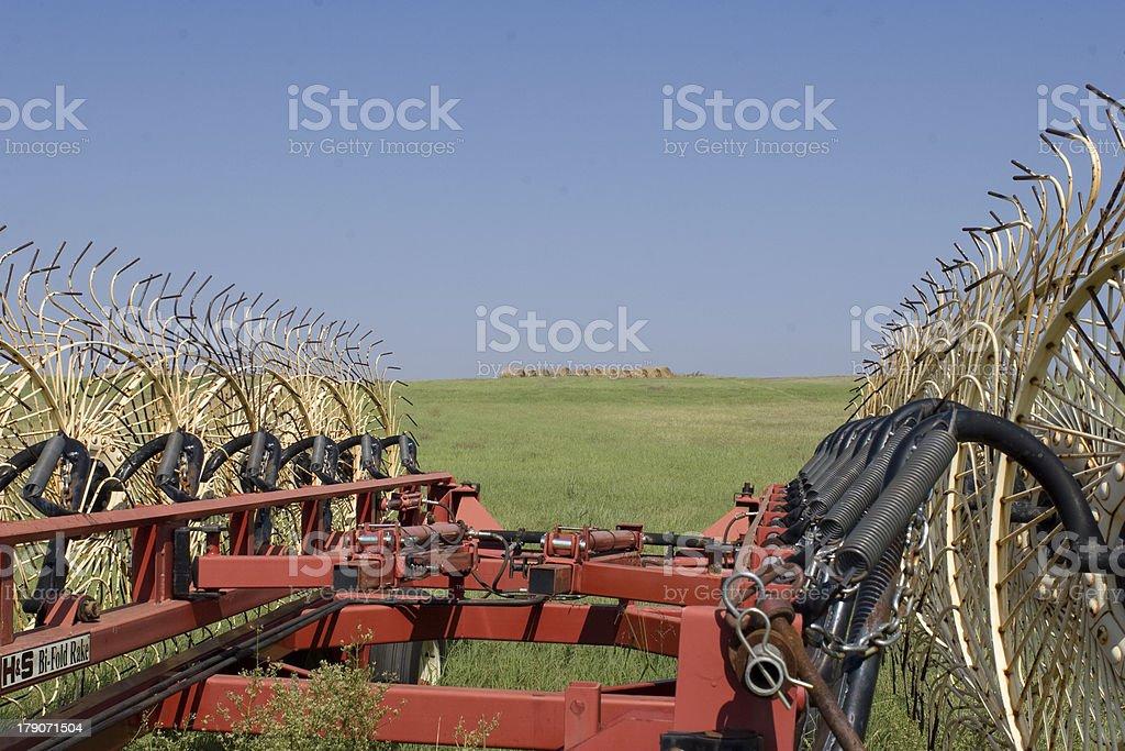 Farming Equipment, Side Rake in green field royalty-free stock photo