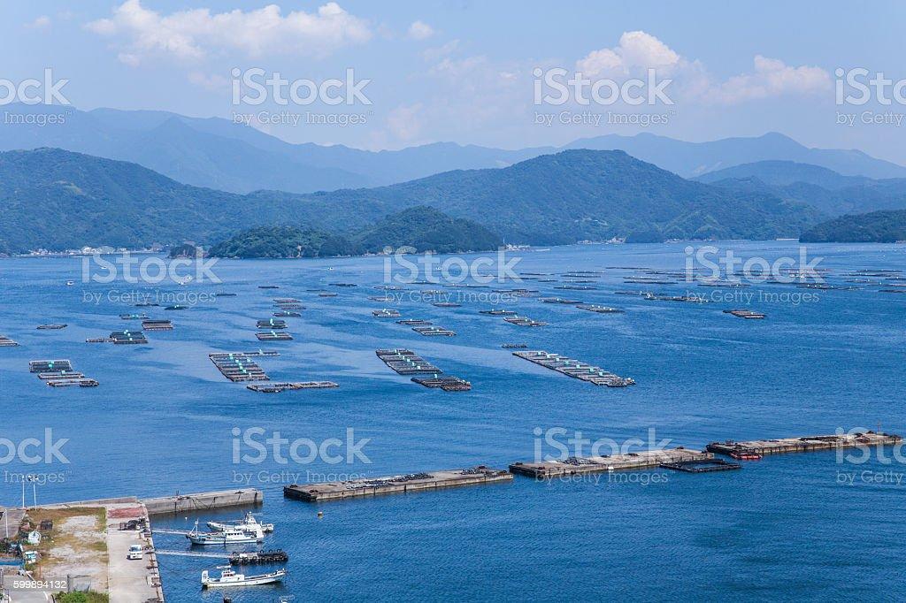 Farming rafts and fishing boats of Uwakai in Japan stock photo