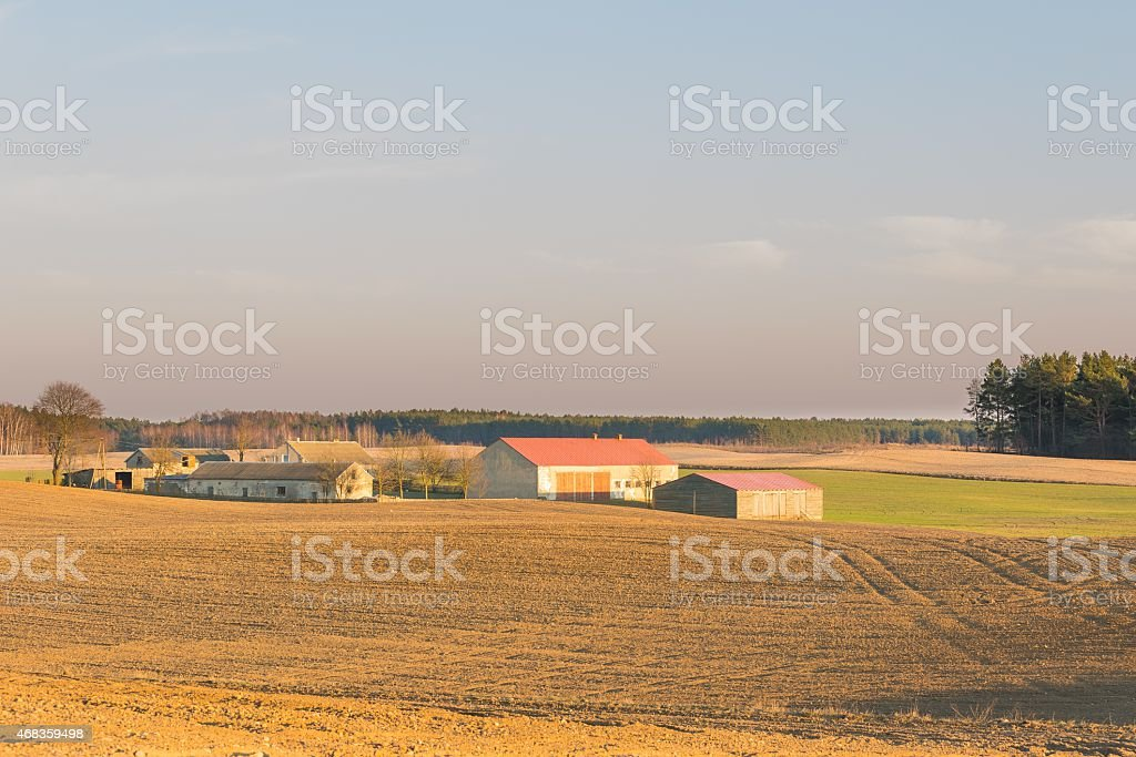 Farmouses on plowed fields royalty-free stock photo
