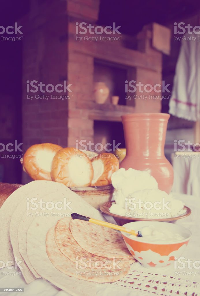 farm-style meal on table stock photo