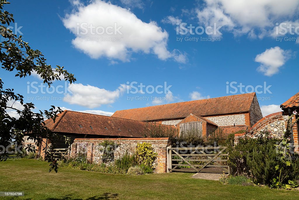 Farmyard gate, outbuildings and barn stock photo