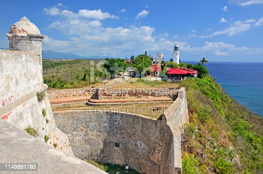 The Castillo de San Pedro de la Roca is a fortress on the coast of the Cuban city of Santiago de Cuba. The fortress was declared a World Heritage Site by UNESCO in 1997. Faro del Morro on background is one of oldest lighthouse built in 1842