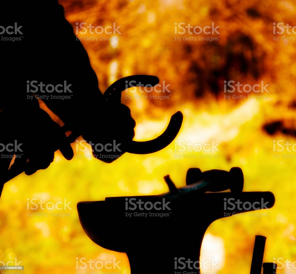 farrier at work stock photo