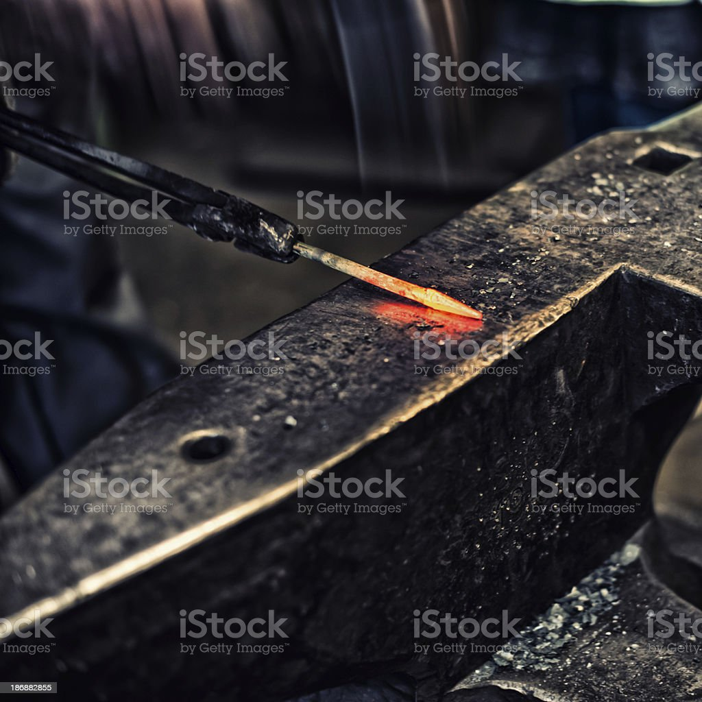 farrier man working with hammer on anvil royalty-free stock photo