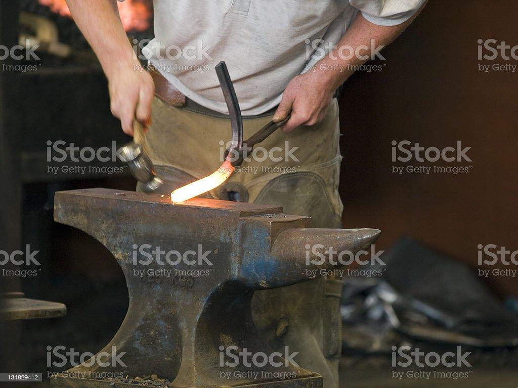 Farrier Shaping a Horseshoe stock photo