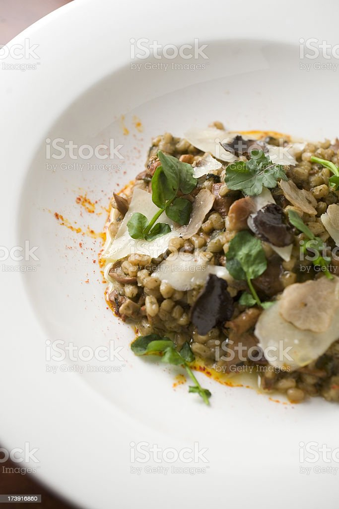 Farro risotto with black truffle stock photo