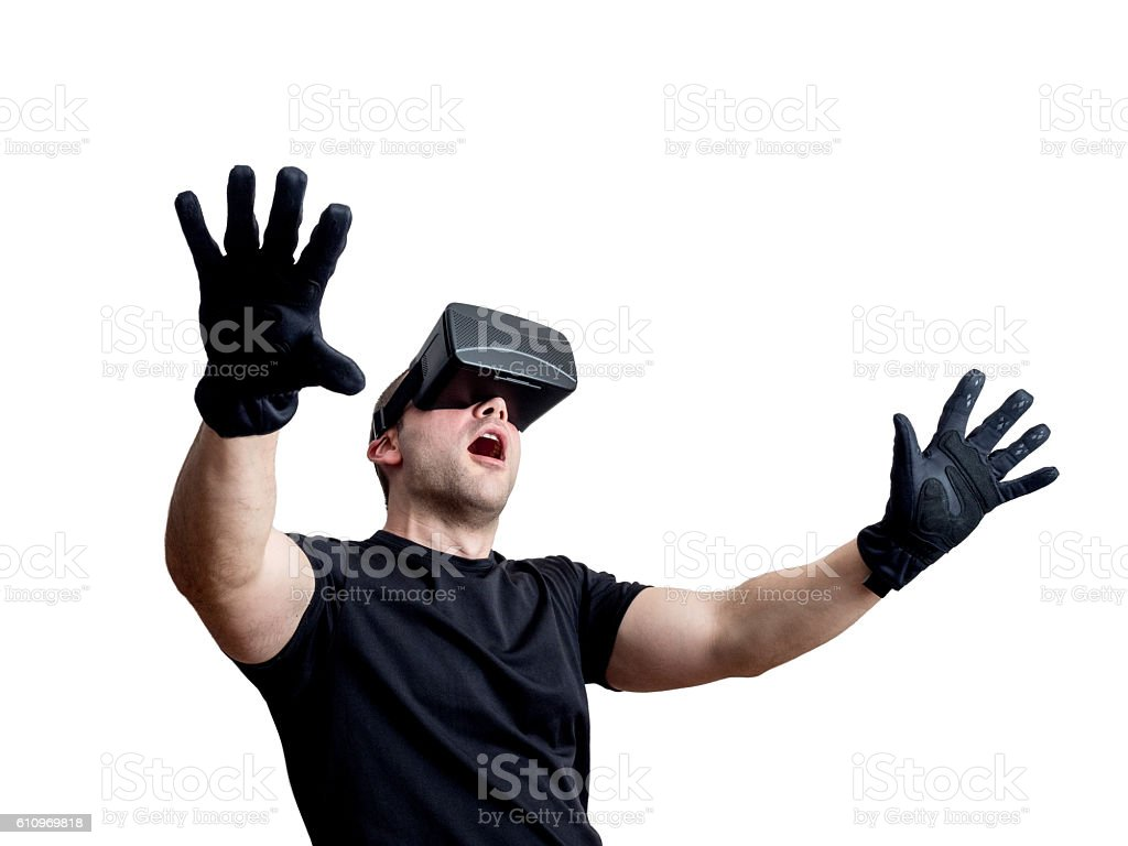 Fascinated man using virtual reality glasses isolated over white background stock photo