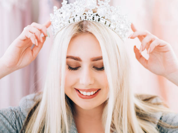 fashion accessories lady special occasion look Fashion accessories. Closeup portrait of smiling lady wearing tiara, creating look for special occasion. prom night stock pictures, royalty-free photos & images