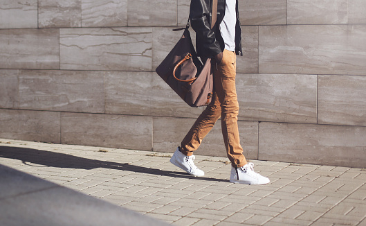 istock Fashion african man in black jacket walking in city 627398448