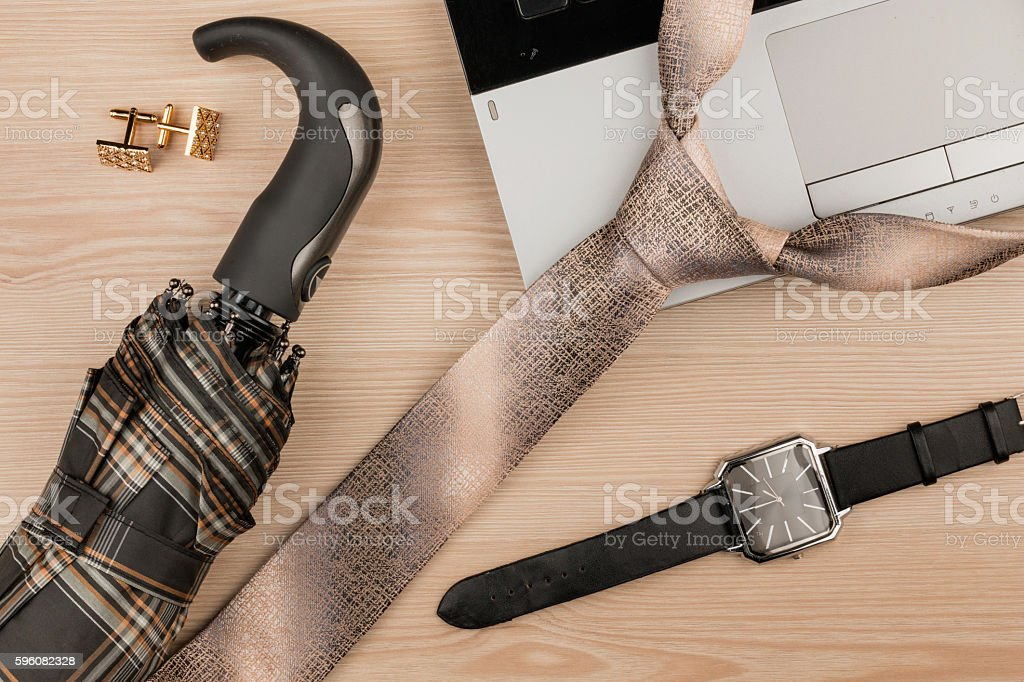 Fashion and business, notebook and tie on a wooden table royalty-free stock photo
