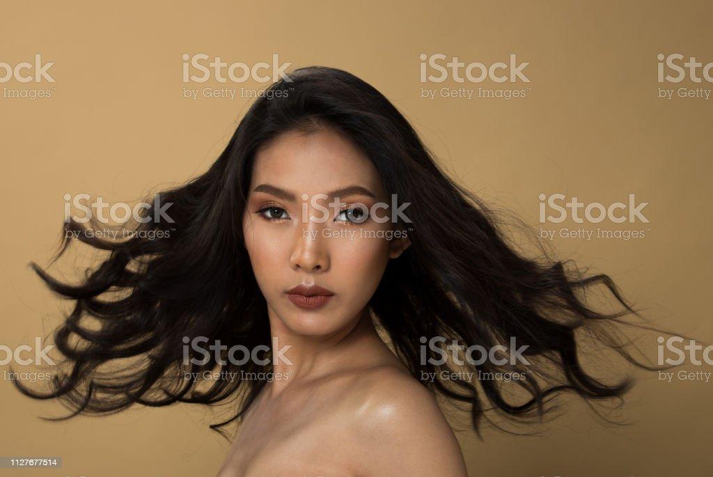 Fashion Asian Woman Tan skin black hair eyes stock photo