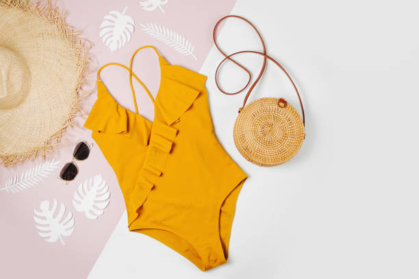 Fashion bamboo bag and sunglass, straw hat and swimsuit. Flat lay, top view. Summer Vacation concept. Fashion bamboo bag and sunglass, straw hat and swimsuit. Flat lay, top view. Summer Vacation concept. swimwear stock pictures, royalty-free photos & images