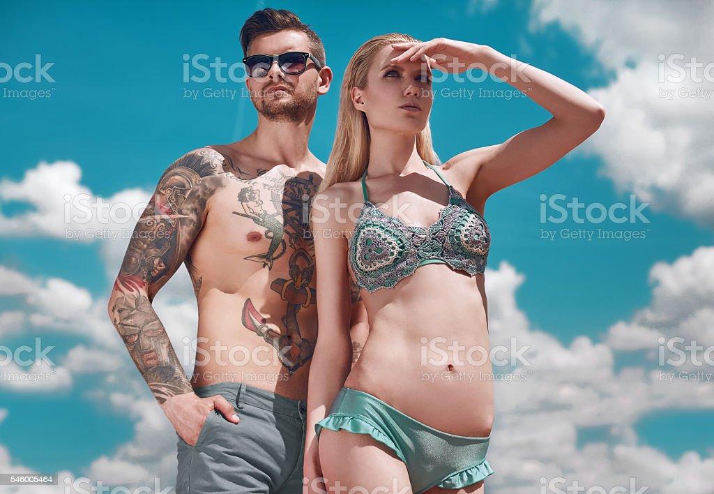 Fashion beautiful couple getting a suntan stock photo