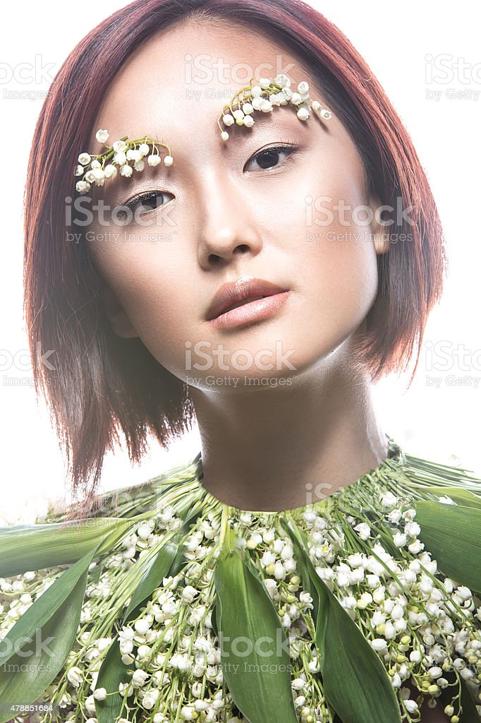 Fashion beautiful girl oriental type with delicate natural make-up stock photo