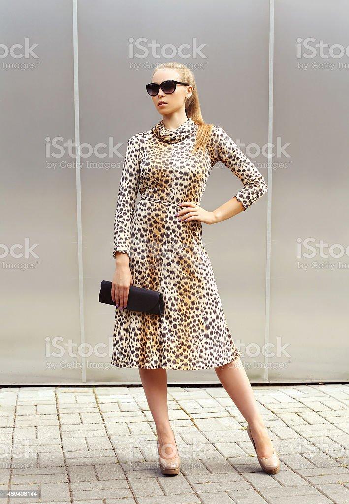Fashion beautiful woman wearing a leopard dress and sunglasses w stock photo