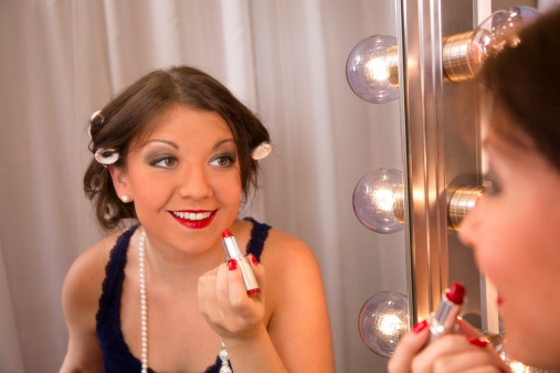 109721176 istock photo Fashion: Beautiful young woman's reflection in a hollywood make-up mirror. 176431148