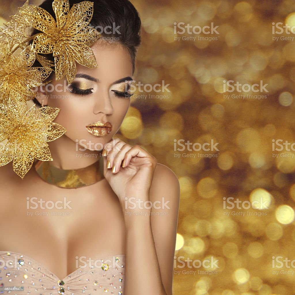 Fashion Beauty Girl portrait with flowers Isolated over golden royalty-free stock photo