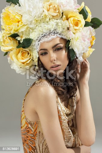 1169941952istockphoto Fashion beauty model girl with flowers hair 512628691