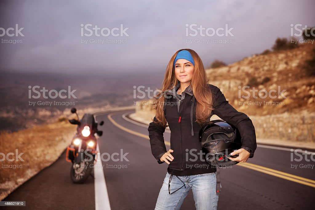 Fashion biker girl stock photo