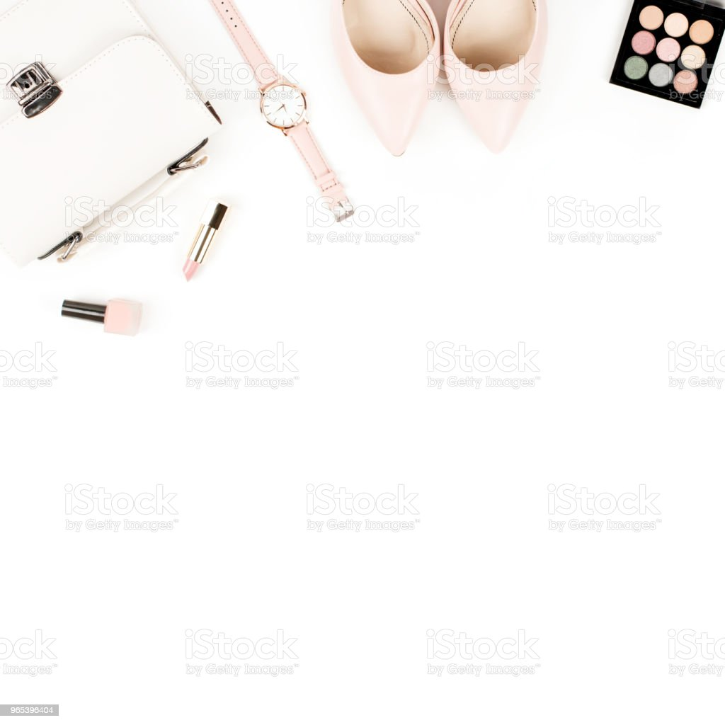Fashion blogger workspace flat lay with pumps, cosmetics, purse, planner book and flowers. zbiór zdjęć royalty-free