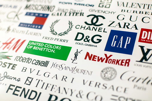 Collection of famous fashion brand and designers' logos including Dolce Gabanna, Benetton, H&M, Tommy Hilfiger, LaCoste, Chanel, Roberto Cavalli and many more printed on quality paper and shot with a high resolution camera.