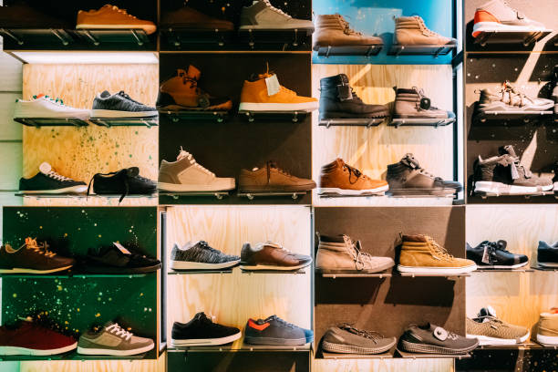 Fashion Casual Male Sneakers On Shelves In Store Of Shopping Center stock photo