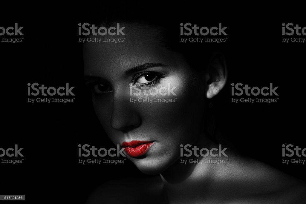 Artistic beauty portrait of young woman with creative lighting...