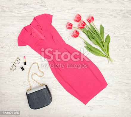 istock Fashion concept. Crimson dress, handbag, lipstick, glasses and pink tulips. 675971760