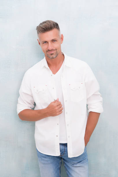 Fashion concept. Man model clothes shop. Mature man model. Feeling comfortable day by day. Menswear and fashionable clothing. Man looks handsome in casual shirt. Guy with bristle wear casual outfit stock photo