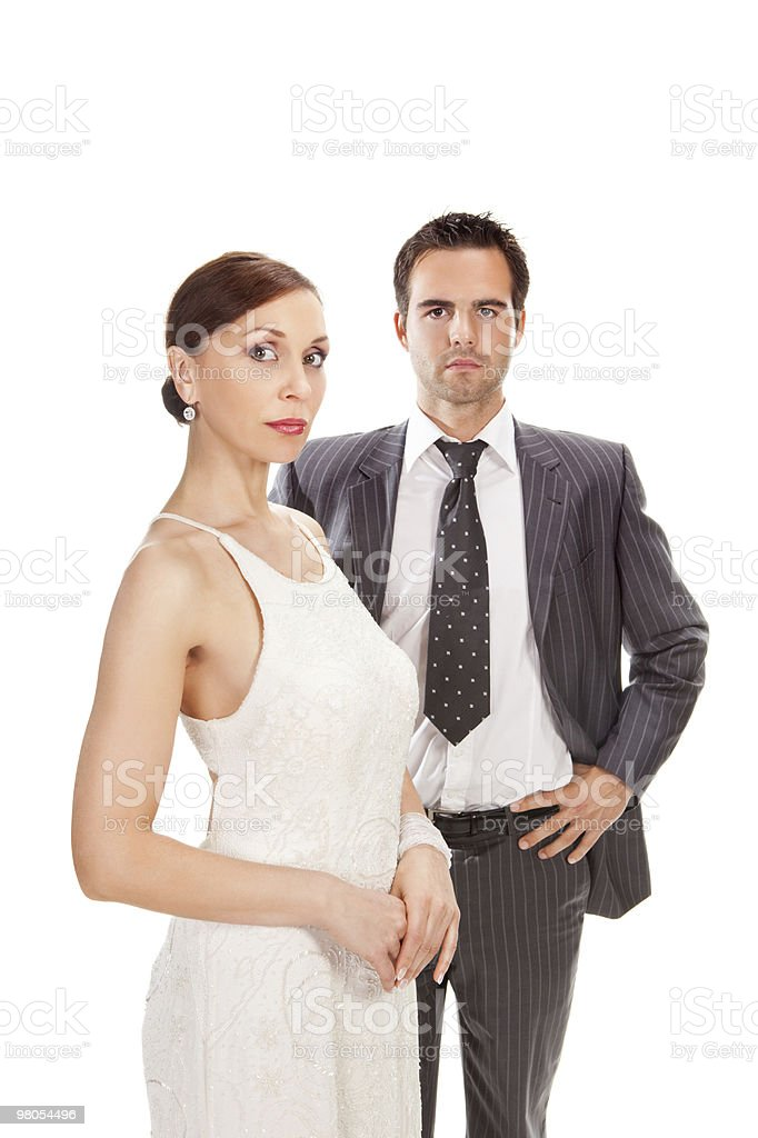 Moda coppia, studio colpo su bianco foto stock royalty-free