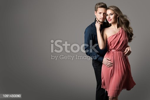 istock Fashion Couple, Young Beautiful Woman in Summer Dress and Elegant Man Studio Beauty Portrait 1091430090
