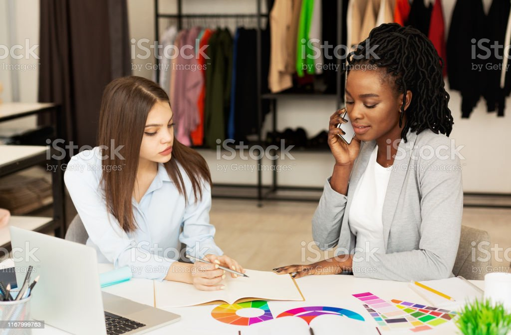 Fashion Couturier And Assistant Discussing Order With Customer On Phone Stock Photo Download Image Now Istock