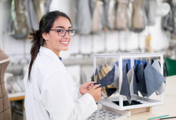 Fashion design student at the university Portrait of a happy Latin American fashion design student at the university looking at the camera smiling designer baby stock pictures, royalty-free photos & images
