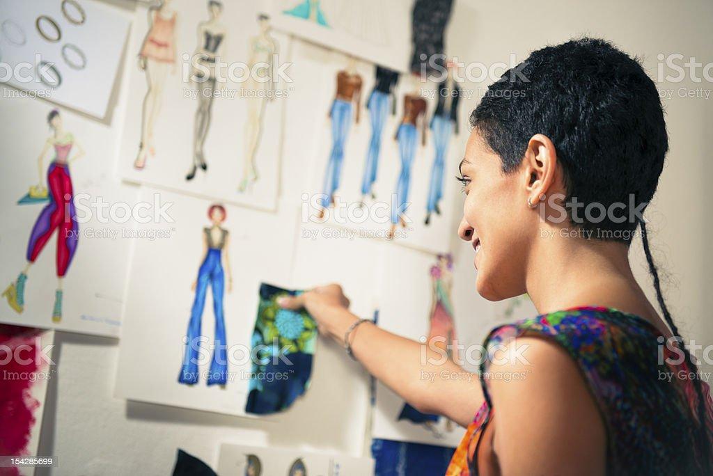 A fashion designer admiring her past work stock photo