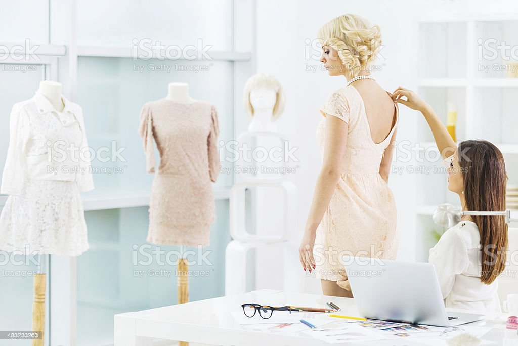 Fashion designer and her client. stock photo
