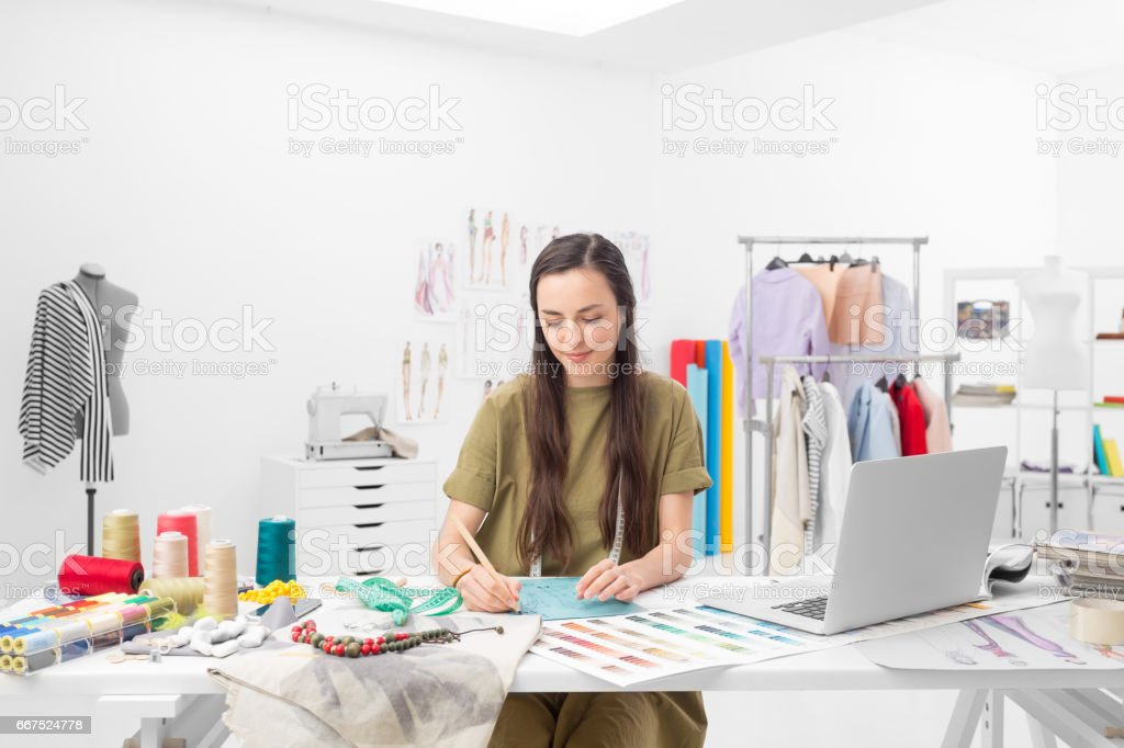 fashion designer drawing a concept stock photo