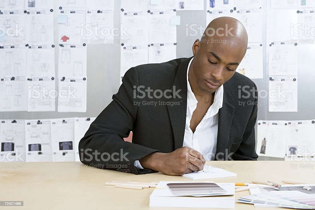 Fashion designer drawing royalty-free stock photo