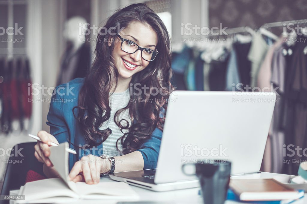 Fashion designer in her showroom stock photo