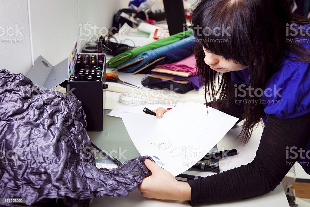 fashion designer in her studio royalty-free stock photo
