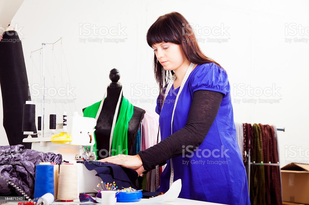 fashion designer in her studio royalty-free stock photo