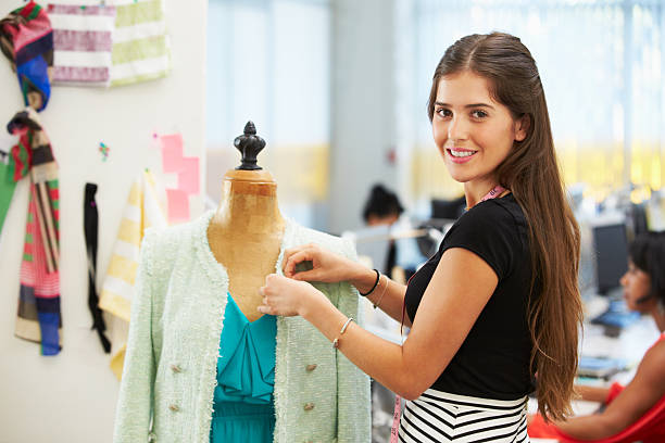 Fashion Designer In Studio Fashion Designer In Studio Designing Mannequin Smiling fashion designer stock pictures, royalty-free photos & images