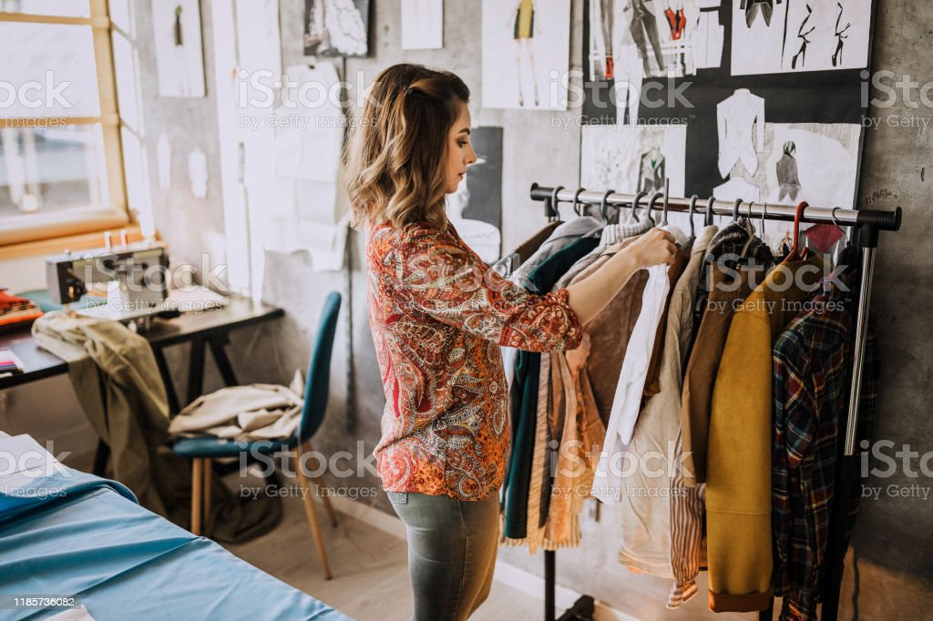 Fashion Designer Looking At Her New Fashion Collection Stock Photo Download Image Now Istock