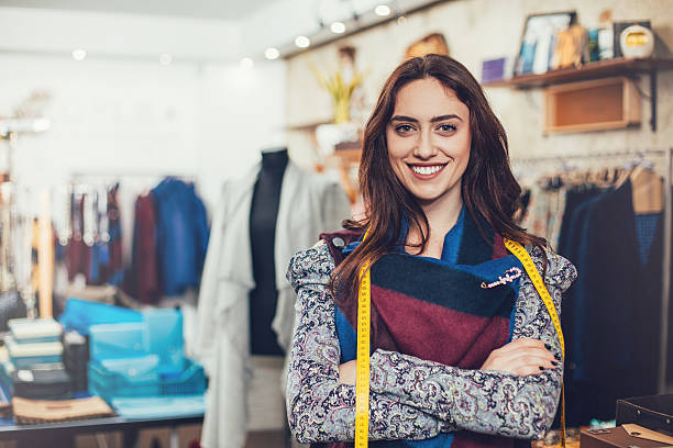 Fashion designer Portrait of young woman smiling at her workshop fashion designer stock pictures, royalty-free photos & images