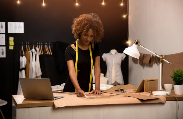 Fashion designer A young fashion designer working on her atelier fashion designer stock pictures, royalty-free photos & images