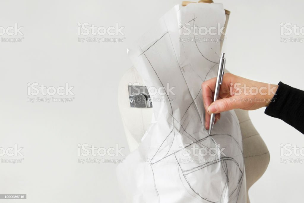 Fashion Designer Putting Dress Templates On Mannequin Stock Photo Download Image Now Istock