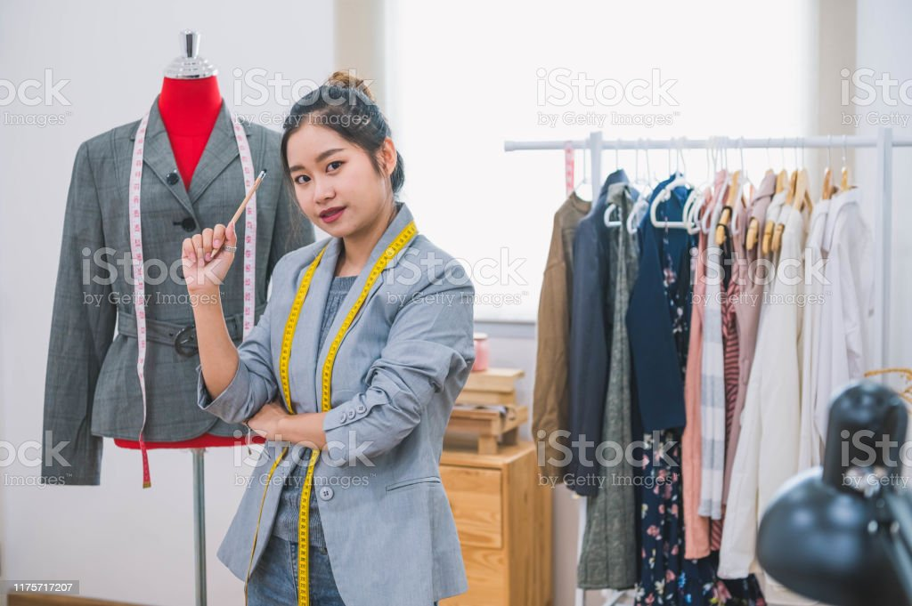 Fashion Designer Stylist In Business Owner Workshop Tailor And Sewing Concept Portrait Of Happy Casual Trendy Fashion Designer Businesswoman In Studio Looking Camera Business Job And Occupation Stock Photo Download Image