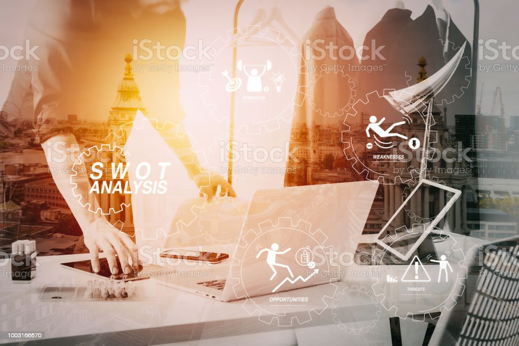 Fashion Designer Talking Mobile Phone And Using Laptop With Digital Tablet Computer In Modern Studio Stock Photo Download Image Now Istock