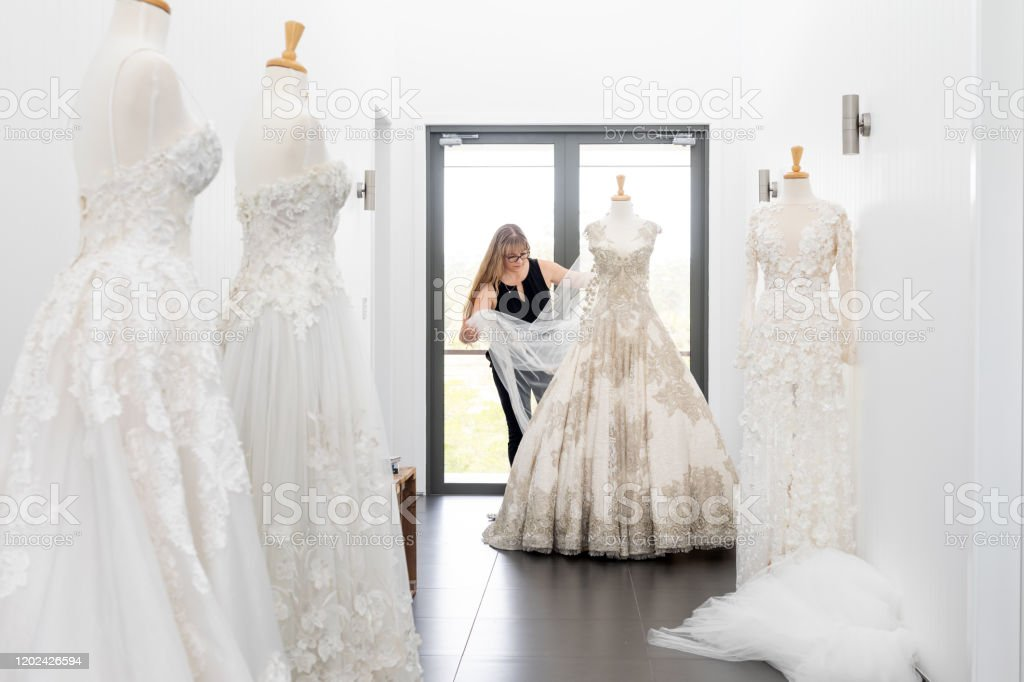 Fashion Designer Working On Couture Bridal Gown On Mannequin Stock Photo Download Image Now Istock