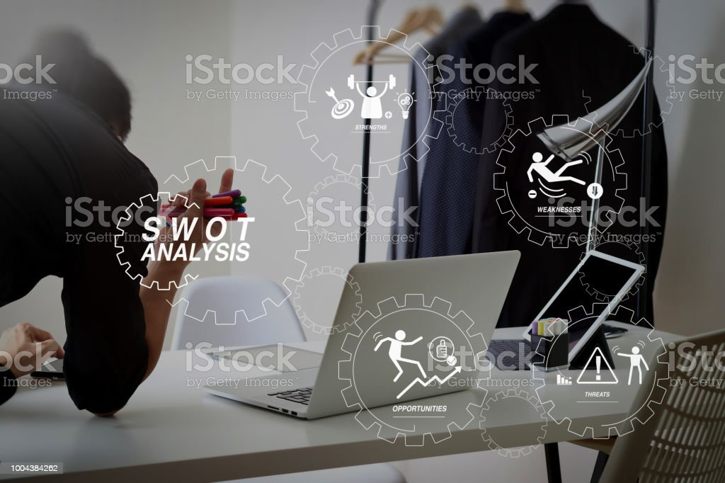 Fashion Designer Working With Mobile Phone And Using Laptop With Digital Tablet Computer In Modern Studio Stock Photo Download Image Now Istock